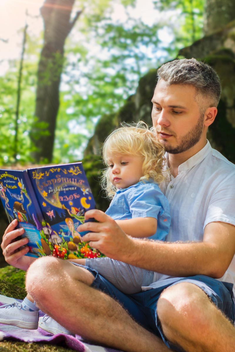Dad Reading to Child - Custody & Visitation